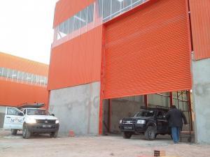 Porte rideau métallique industriel motorisée